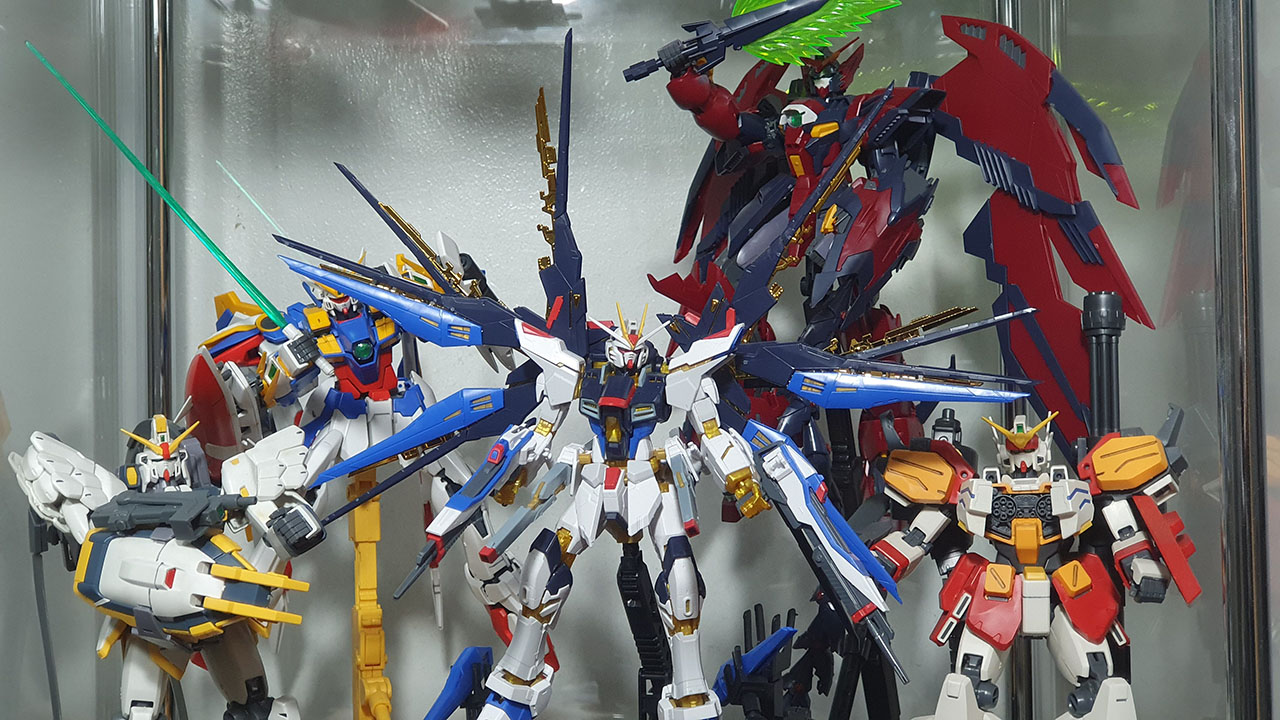 My current Gundam collection including MG Wing and RG Seed version. :)